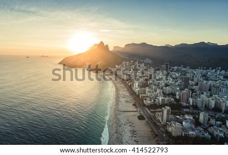 Aerial view of sunset behind the mountains on the beach Rio De Janeiro, Brazil - stock photo