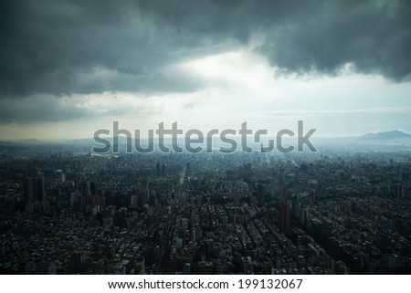 Aerial view of Taipei, Taiwan under a cloudy sky. - stock photo