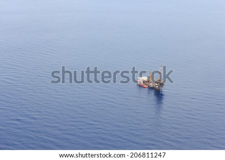 Aerial View of Tender Drilling Oil Rig (Barge Oil Rig) in The Middle of The Ocean - stock photo