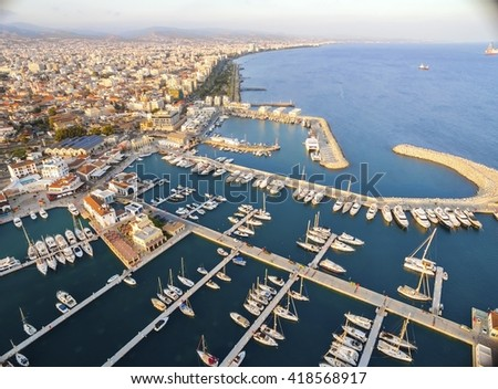 Aerial view of the beautiful Marina in Limassol city in Cyprus,beach,boats,piers,villas, commercial area,old port (palio limani) and Molos. A modern,high end,newly developed space with docked yachts.  - stock photo