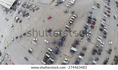 Aerial view of the big parking with car in city. - stock photo