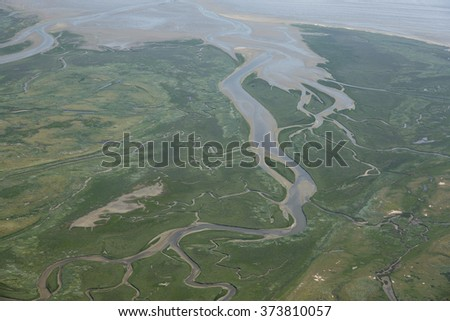 Aerial view of the Boschplaat at Terschelling, an island in the Waddenzee, Holland. The Waddenzee is on the UNESCO world heritage list. - stock photo