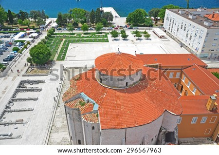 Aerial view of the byzantine church of St Donatus in the remains of the roman forum, in Zadar, Croatia. In the background the Adriatic Sea. - stock photo