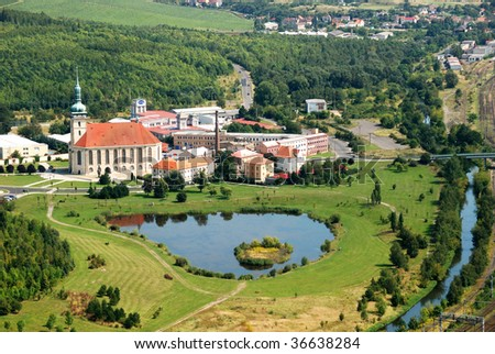 Aerial View of The Church of the Assumption of Virgin Mary in Most, Czech Republic that was moved by  842 meters to avoid demolition. - stock photo