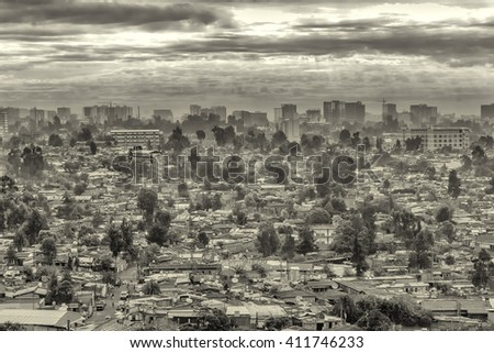 Aerial view of the city of Addis Ababa covered by dark clouds - stock photo