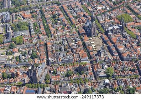 Aerial view of the city of Delft, the Netherlands with the Old Church, New Church and the old Town hall - stock photo