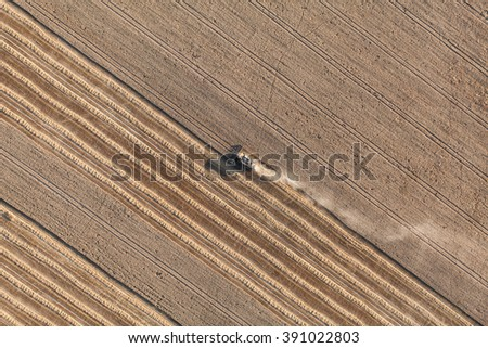aerial view of the combine on harvest field in Poland in summer - stock photo
