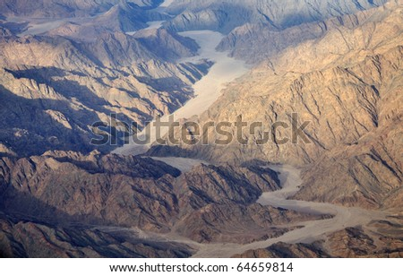 Aerial view of the egyptian mountains and sand plateaus - stock photo