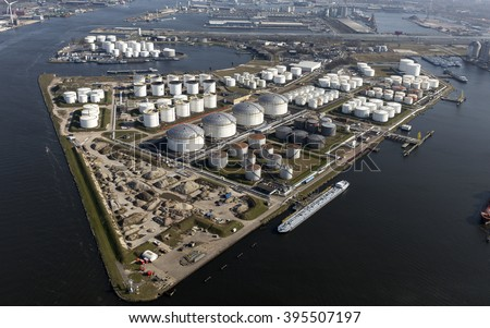 Aerial view of the Eurotank terminal with lots of white oil storage tanks in the harbour of Amsterdam. - stock photo