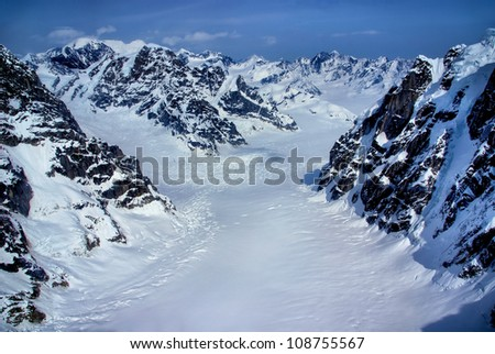Aerial View of the Headwaters of a Beautiful Glacier in the Great Alaskan Wilderness, Denali National Park, Alaska.  A Beautiful Snowscape of Rock, Snow, and Ice. - stock photo
