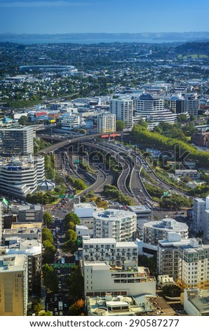 Aerial view of the internal road traffic in the city of Auckland in New Zealand from SkyTower - stock photo