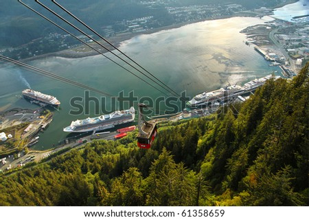 Aerial view of the Juneau, Alaska waterfront and cruise ship dock as seen from the Mount Roberts Tramway. - stock photo