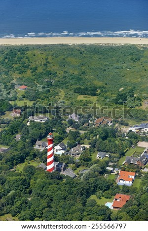 Aerial view of the lighthouse (Westerlichttoren) of the village of Haamstede on the island of Schouwen-Duiveland in the province of Zeeland, the Netherlands. - stock photo