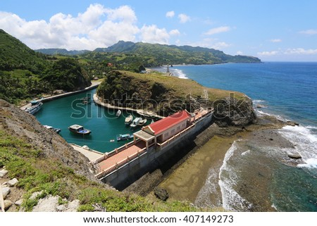 Aerial view of the Mahatao sheltered port at Batan island in Batanes, Philippines - stock photo