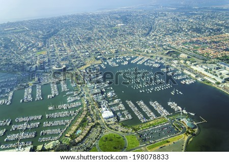 Aerial view of the Marina in Point Loma peninsula, San Diego, Southern California, United States of America. A view of shelter island, the pier, dock, Rosecrans street and yachts moored in the bay. - stock photo