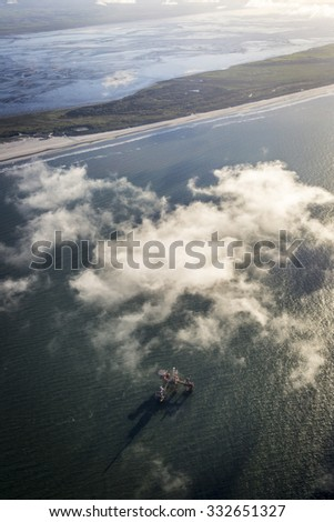 aerial view of the mudflat coastline at low tide, Frisian island Ameland, The Netherlands - stock photo