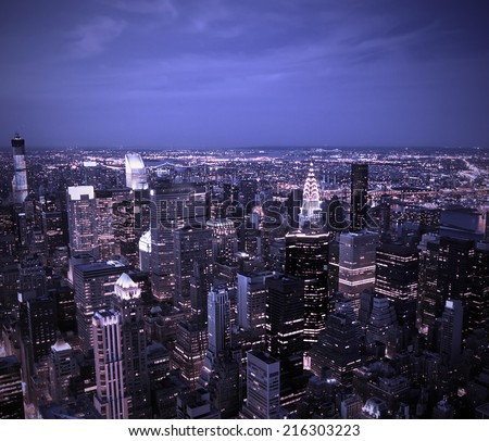 Aerial view of the New York City Skyline at sunset with a blue hue - stock photo