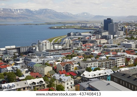 Aerial view of the North of Reykjavik, the capital of Iceland under steely blue skies - stock photo