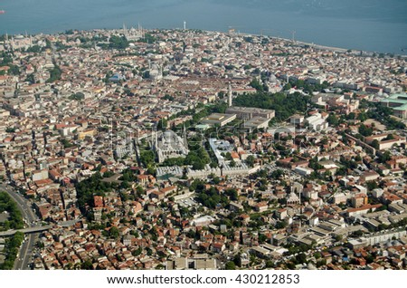 Aerial view of the old city of Istanbul with the mosques of Murat Pasa Camii, Beyazit Camii, and the famous Blue Mosque dominating the skyline. - stock photo