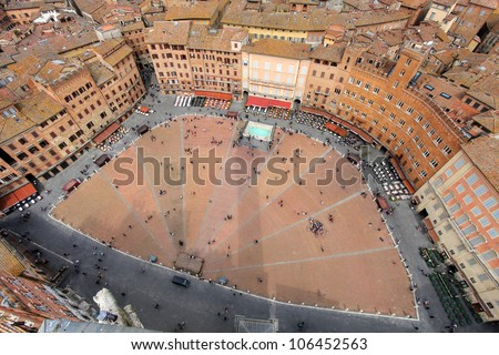 Aerial view of the Piazza del Campo, Siena, Tuscany, Italy as seen through a wide angle lens from the Torre del Mangia. - stock photo