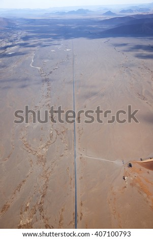 Aerial view of the road to the sand dunes of Sossusvlei, Namibia, Africa - stock photo