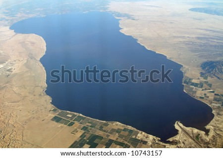 Aerial view of The Salton Sea, surrounded by the Imperial Valley and the Mojave Desert - stock photo