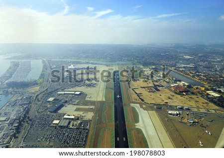 Aerial view of the San Diego International Airport, river and pacific ocean, in Southern California. Lindbergh Field is the busiest single runway commercial airport in the United States of America. - stock photo