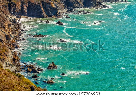 Aerial view of the scenic rocky northern California coastline revealing hidden Pirate's Cove beach. Location: Marin County north of San Francisco - stock photo