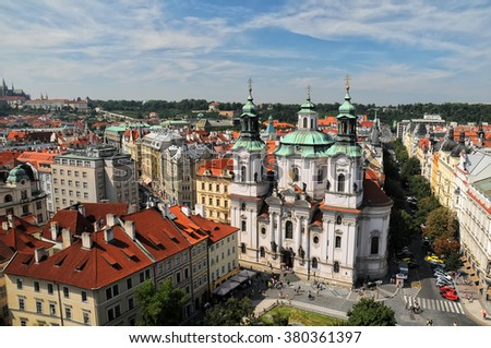 Aerial view of the St. Nicholas church and red roofs in the Old Town Square in Prague, Czech Republic - stock photo