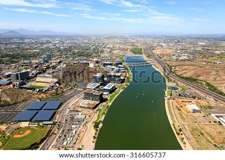 Aerial view of the Tempe Town Lake looking to the West with Phoenix, Arizona in the distance - stock photo