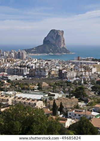 Aerial view of the town of Calpe (Costa Blanca - Spain), with the Mediterranean Sea and the Rock of Ifach on the background - stock photo