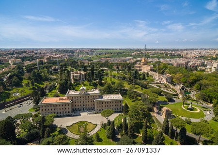 Aerial view of the Vatican City and Rome, Italy. Palace of the Governorate, Gardens, Vatican Radio, Convent. Panorama of the old historical center. View from the roof of Saint Peter Basilica. - stock photo