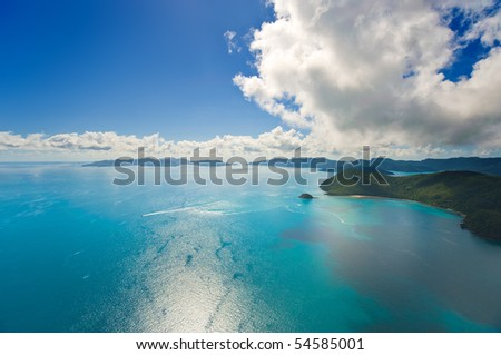 Aerial view of the Whitsunday Islands and brilliant ocean - stock photo