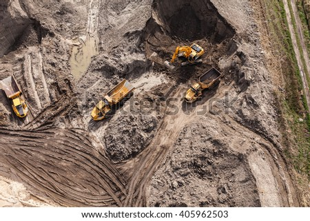 Aerial view of the working earth mover in Poland - stock photo
