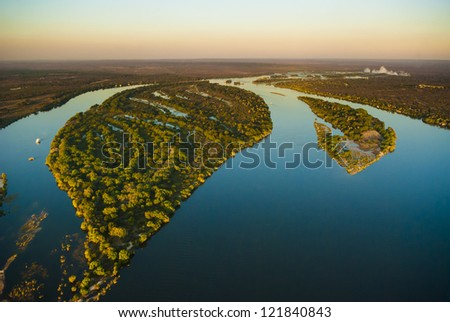Aerial view of the Zambezi river with riverboats - stock photo