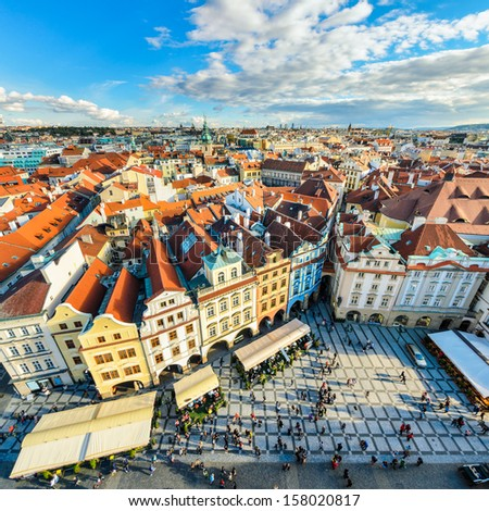 Aerial view of traditional red house roofs at the Prague Old Town Square, Czech Republic - stock photo