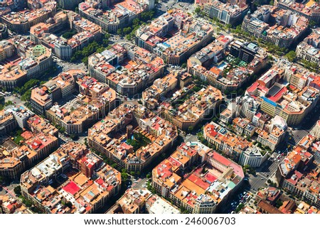 Aerial view of  typical buildings of Barcelona cityscape from helicopter. Catalonia, Spain - stock photo
