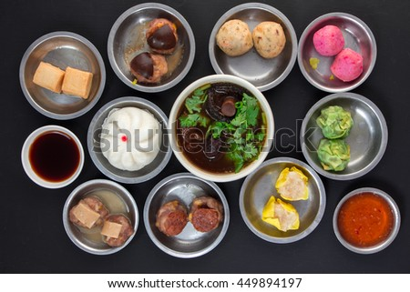 Aerial View of Various Yumcha Dimsum Set on black background - stock photo
