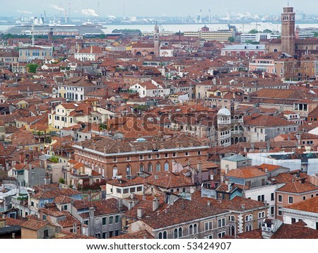 Aerial view of Venice. Houses, sea, sea port and industry from San Marco tower - stock photo