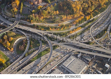 Aerial view of vivid colors at a major, complex interstate junction - stock photo