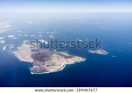 Aerial view of volcanic island Isla de Alegranza in Lanzarote. - stock photo