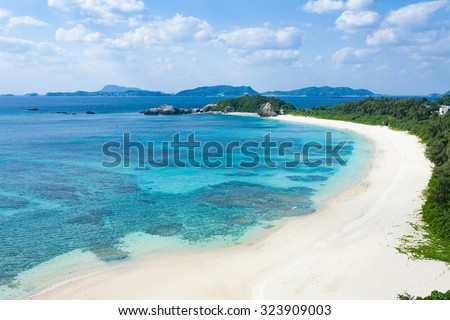 Aerial view of white sand tropical beach with clear blue water, Tokashiki Island of Kerama Islands National Park, Okinawa, Japan - stock photo