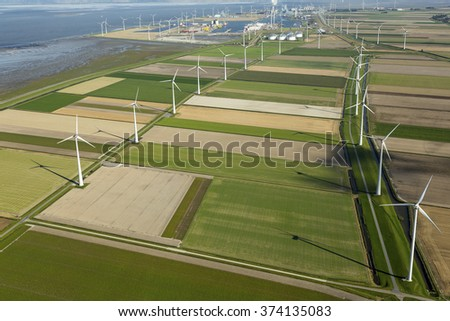 Aerial view of wind turbine farm in the Eemshaven, The Netherlands.  - stock photo