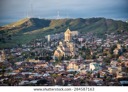 Aerial view on Tbilisi with Holy Trinity Cathedral (left side) - stock photo