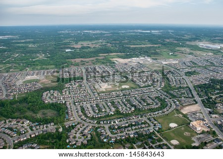 Aerial view over a residential suburb - stock photo