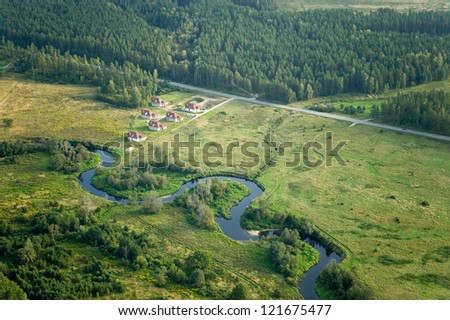Aerial view over agricultural fields and small river - stock photo