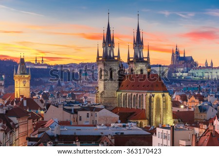 Aerial view over Church of Our Lady before Tyn, Old Town and Prague Castle at sunset in Prague, Czech Republic  - stock photo