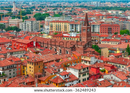 Aerial view over Church of St. Helena and red roofs  in cloudy summer day, Verona, Italy - stock photo