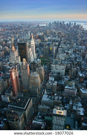 Aerial view over lower Manhattan from Empire State building top, New York at sunset - stock photo