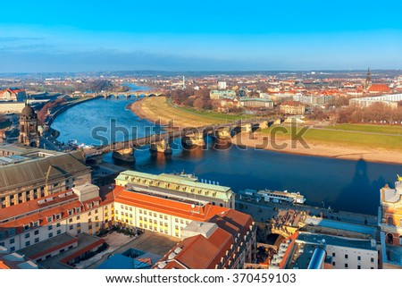 Aerial view over river Elbe with Augustus Bridge and roofs of old Dresden, Saxony, Germany - stock photo